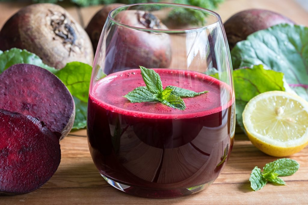Red Beet Juice In A Glass On A Wooden Background